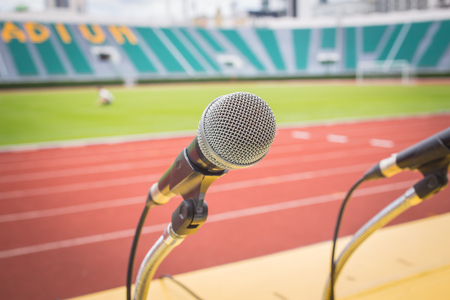 Microphone on table side sport field in stadium for commentator. Stock Photo