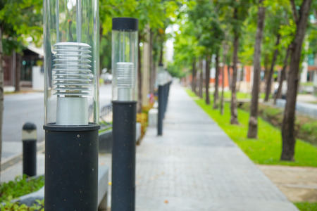mersey: light pole with footpath with in university campus or public park.