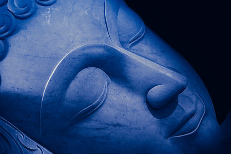 Close up beautiful sleeping Buddha face with painting art effect. Stock Photo