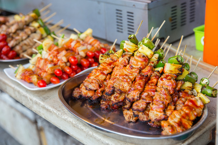 Grilled BBQ in Thai street food market. Stock Photo