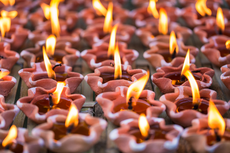 Light Candle lamp Buddha pray in Thailand Temple. Stock Photo