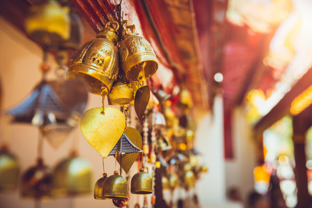 wallpaper copper gold golden: Bell in Thailand temple. Buddha worship copper golden small Buddhist bell hanging at chapel. Stock Photo