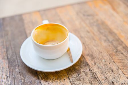 empty coffee cup on wooden table. Stock Photo