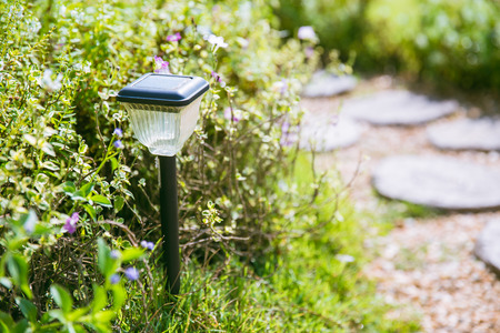 home garden walkway with solar cell light pole.