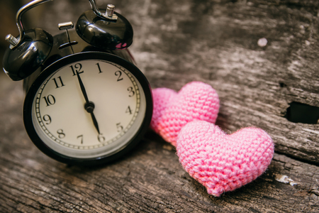 Love clock at 6 oclock, Time of sweet loving pass memories story on the old wood background. Stock Photo