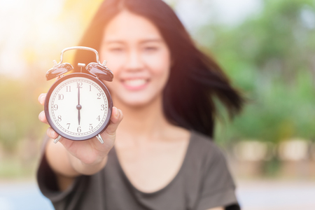 pm: Asian women hand show clock times at 6 oclock, Its time to do something concept. Stock Photo