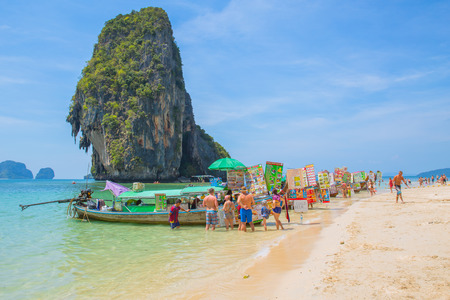 Krabi,THAILAND-February 20,2017:Food boat in the sea at Island sell food and drink many with tourist at sea islands of Phi Phi Krabi Phuket most attractive travel landmark popular in summer season.