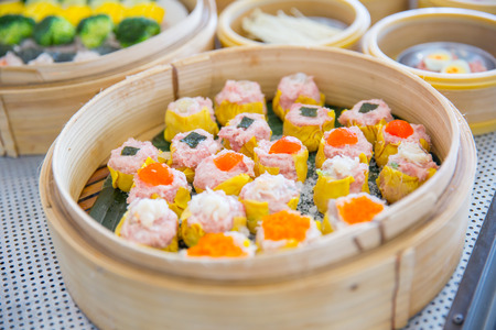Yumcha or Dim sum, Chinese cuisine style steam food served in bamboo stack dish.