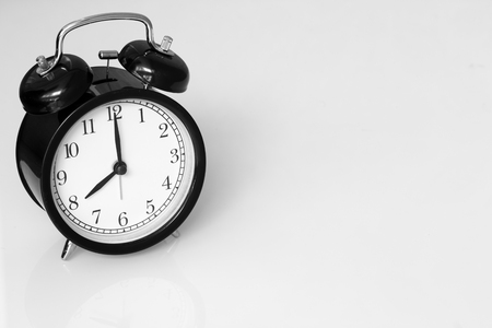 clock retro at 8 oclock on white table background with space for text.