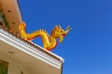 legends: Chinese golden dragon at the roof top of temple. Stock Photo