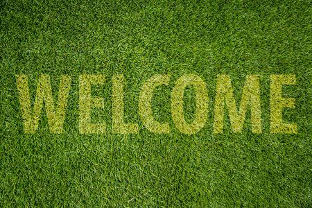 green grass carpet welcome word.