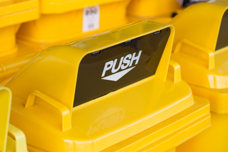 close up top yellow push hole or waste drop hole of trash bin or recycle bin.