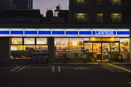 Osaka, Japan - November 11, 2015 : Night Lawson convenience store in Japan. Lawson is small shopping minimart opening 24 hours convenience store chain in Japan.