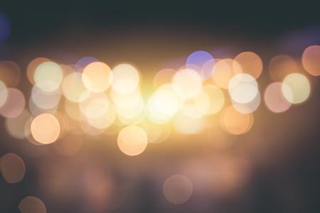 city blur bokeh smooth emotion. gentle yelow night light background vintage tone. Stock Photo