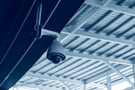 CCTV security camera in ceiling roof building dome outdoor cam.