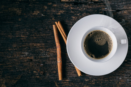 Hot Coffee, Espresso Coffee cup. Cinnamon Coffee on wood table. Stock Photo