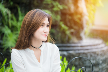 portait single asian beautiful women adult smile in the park. enjoy healthy good life and lifestyle concept.