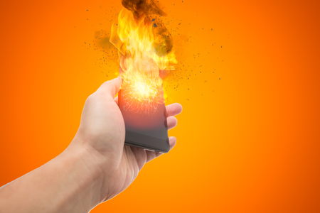 smartphone explosion, blow up cellphone battery or explosive mobile phone or explode burst fire burn out smart device with dispersion effect. Foto de archivo