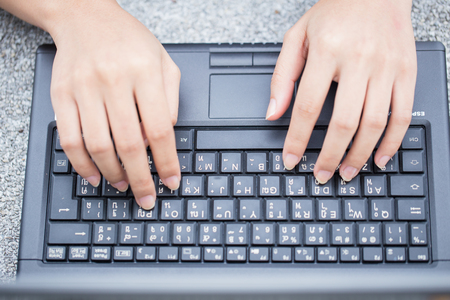 homeoffice: finger at laptop keyboard. working lifestyle, closeup business woman typing on computer. Stock Photo