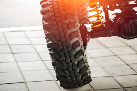 off-road car tilted show suspension and shock-up system and mud tire for adventure.