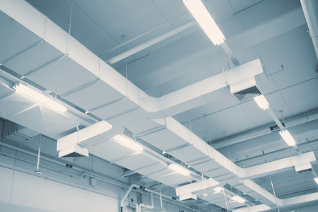 Industrial Airflow in factory, Air duct, Danger and the cause of pneumonia in office man.