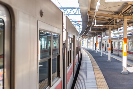 Train station in Japan quiet clean and new in urban city metro central transport system.