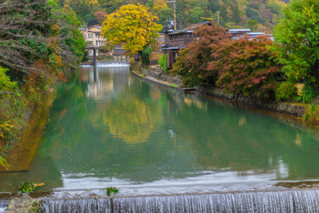 clean water canal in Japan with beautiful nature green tree landscape of countryside in Kyoto.