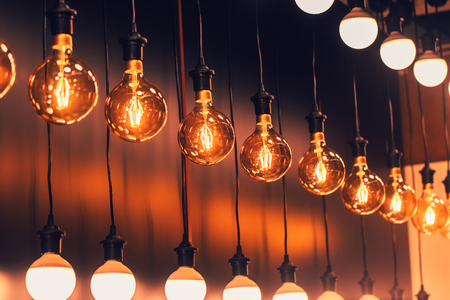 Row of Retro industrial loft style hanging tungsten lamp bulb decoration old vintage modern home.