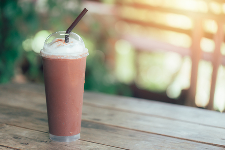 Iced blend smoothie milk chocolate whip cream on wood table with space for text
