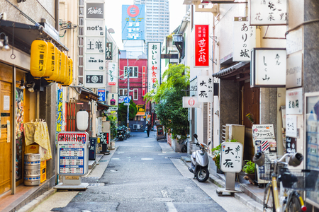 Kobe, Japan - November 12, 2015 :Colorful urban quiet street in Japan with various shop business street sign banner in the city. 報道画像