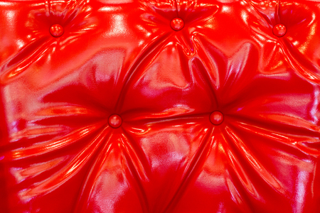 red glossy shiny polished leatherette leather for background texture