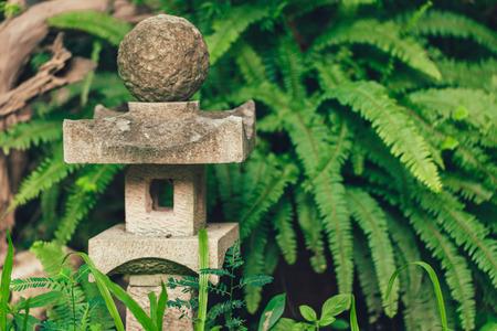 Japan style stone lantern lamp in japanese garden Stock Photo