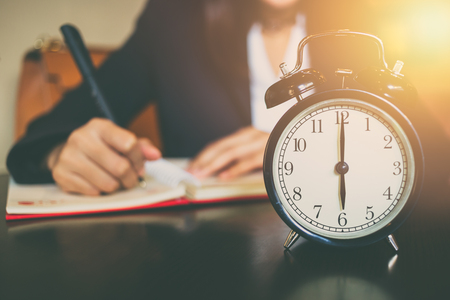 light duty: business working time concept. morning 6 oclock with work people on background Stock Photo