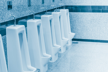 incontinence: Clean urine in the men bathroom Stock Photo