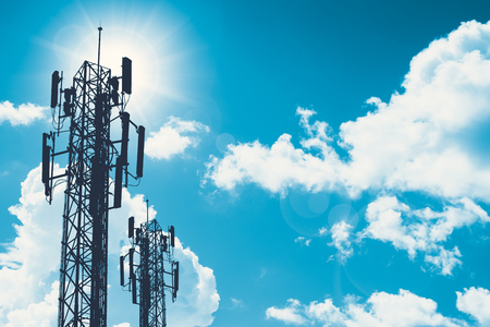 communication tower or 3G 4G network telephone cellsite silhouette on blue sky and space for text Archivio Fotografico