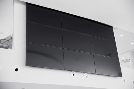 windows: multiple screen LCD panel display in modern building office wall with clipping path at screen Stock Photo