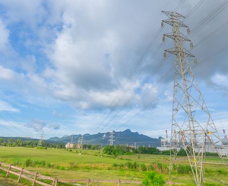 cattle grid: power plant with high voltage electricity power line blue sky countryside view at Maemoh Lampang Thailand.