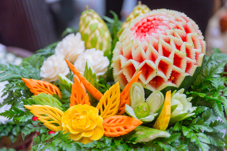 Thai traditional food decoration culture fruit carved shape beautiful flowers Stock Photo