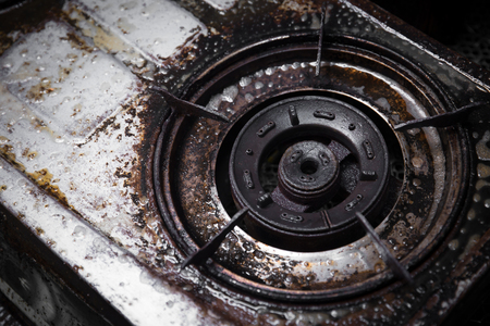 dirty gas stove grunge with oil grease black burn stain old unclean need to scrub Stock Photo