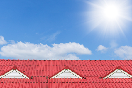house roof top on blue cloud sunny day sky background with space