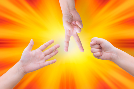rock paper scissor hand play of three people Stock Photo