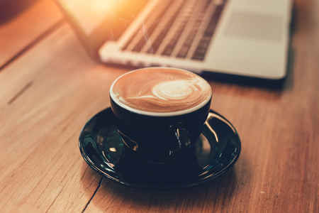 latte coffee while working with laptop computer background