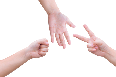 kids hands playing rock paper scissors isolated on white