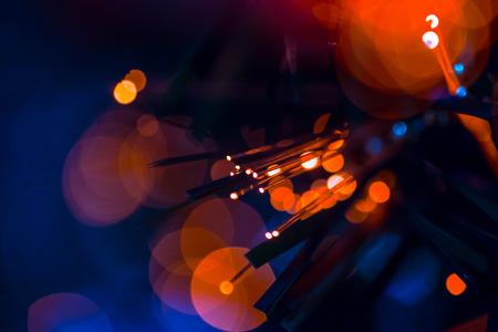 Fiber optics red blue lights bokeh communication technology background
