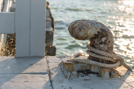 Mooring bollard old grunge rusty for mooring boats at maritime docks Stock Photo
