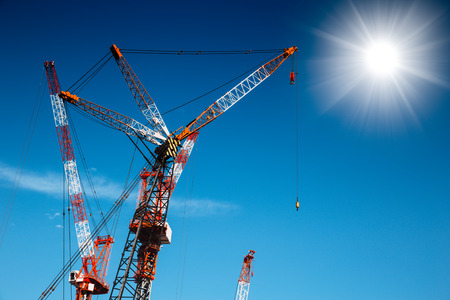 Cranes on blue sky with sunny in summer season Stock Photo