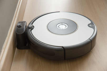 robot vacuum cleaner return to charging at dock in clean room floor