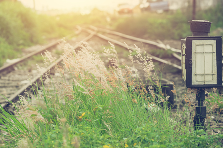 green grass with railway split blur background beautiful  light vintage color tone Archivio Fotografico