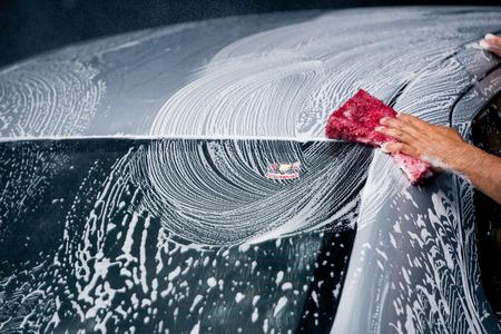 washing car using nano sponge with foam on a car wash Stok Fotoğraf