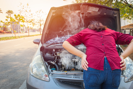 asian women worry and stress a trouble with car engine crash overheat